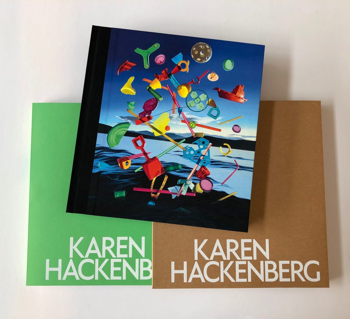 Hackenberg_Hardcover and softcover books_stacked flat